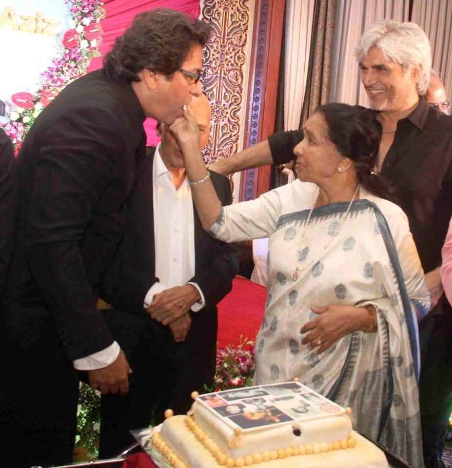 Asha ji feeding cake 2015